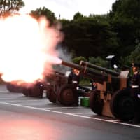 Members of the Self-Defense Forces fire artilleries to mark the proclamation of Emperor Naruhito's ascension to the throne at a park in Tokyo. | AFP-JIJI