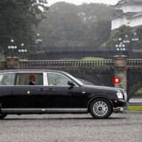 Emperor Naruhito arrives at the Imperial Palace on Tuesday. | REUTERS