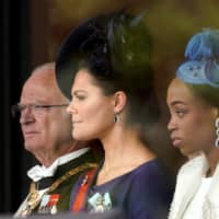 Swedish King Carl XVI Gustaf (left) and his daughter, Crown Princess Victoria (center), attend the enthronement ceremony. | POOL / VIA AFP-JIJI