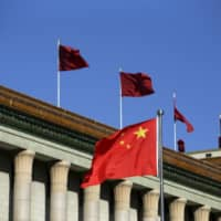 The Chinese flag waves in front of the Great Hall of the People in Beijing in 2015. | REUTERS