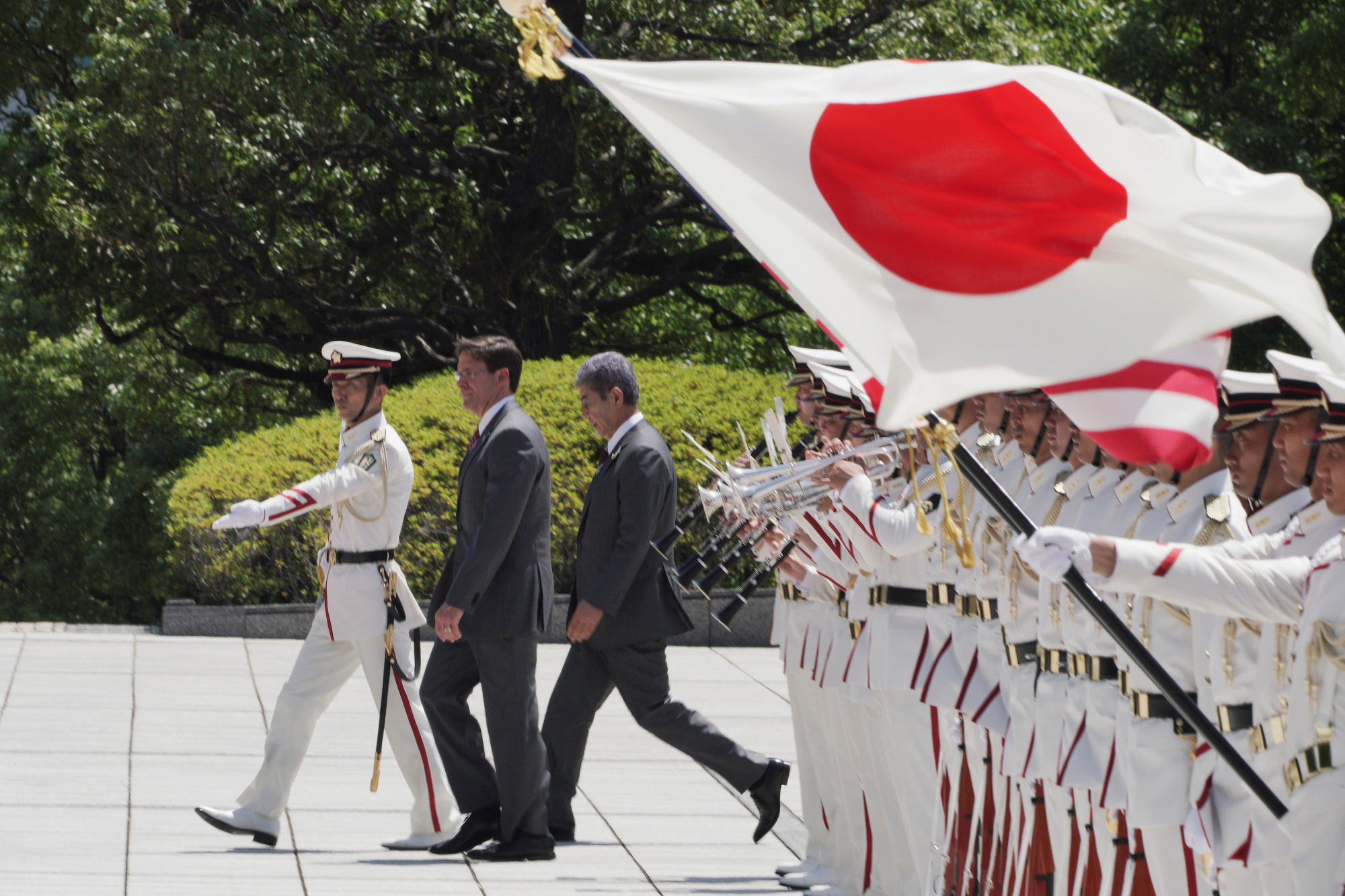 U.S. Secretary of Defense Mark Esper and then-Japanese Defense Minister Takeshi Iwaya inspect an honor guard ahead of their meeting at the Defense Ministry in Tokyo on Aug. 7. | REUTERS