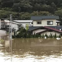 Flooded houses and streets are shown in Motomiya, Fukushima Prefecture, on Sunday in this photo taken by a local resident. | KYODO
