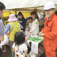 Oral Peace products are distributed at an evacuation shelter after the Kumamoto Earthquake in April 2016. | KYODO
