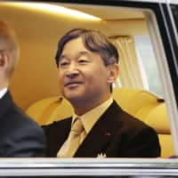 Emperor Naruhito is driven to the Imperial Palace in Tokyo on Tuesday morning for his enthronement ceremony. | KYODO
