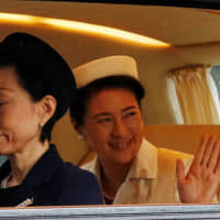 Empress Masako arrives at the Imperial Palace in Tokyo on Tuesday morning for the enthronement ceremony of Emperor Naruhito. | REUTERS