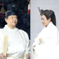 Emperor Naruhito and Empress Masako visit a shrine Tuesday morning prior to the emperor's enthronement later in the day. | POOL / VIA KYODO