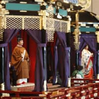 Emperor Naruhito and Empress Masako appear for the emperor's enthronement ceremony at the Imperial Palace in Tokyo on Tuesday afternoon. | KYODO