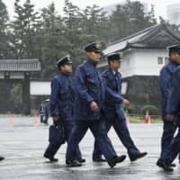 Police officers patrol near the Imperial Palace in Tokyo on Tuesday ahead of Emperor Naruhito's enthronement ceremony. | KYODO