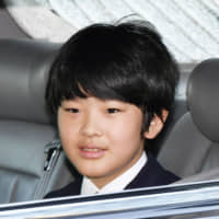 Prince Hisahito, 13, son of Crown Prince Akishino, enters the Imperial Palace by car in Tokyo on Sept. 9. He is the only male heir to the throne from the next generation, raising concerns over the sustainability of the current male-only imperial line.   KYODO