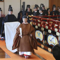 Emperor Naruhito leaves the Pine Chamber of the Imperial Palace in Tokyo after proclaiming his enthronement before roughly 2,000 guests from home and overseas in a ceremony on Tuesday. | POOL / VIA KYODO