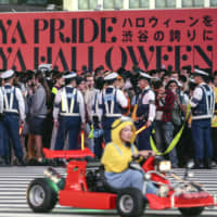 Tokyo's Shibuya abuzz with costumed pre-Halloween merrymakers on weekend amid heavy police presence