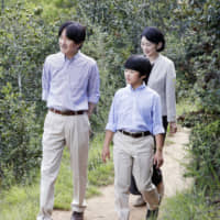 Prince Hisahito and his parents, Crown Prince Akishino and Crown Princess Kiko, walk along a hiking trail in Thimphu, the capital of Bhutan, on Aug. 20. | KYODO
