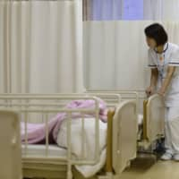Abe-led government panel suggests reducing hospital beds to cut costs