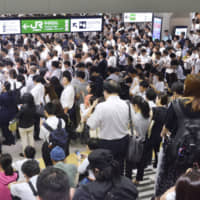 People wait for train services to resume at Urawa Station in Saitama Prefecture on the morning of Sept. 9, after Typhoon Faxai prompted East Japan Railway Co. to suspend all lines in the Tokyo metropolitan area. | KYODO