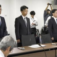 Kansai Electric Power Co. officials visit the Takahama Municipal Assembly in Fukui Prefecture on Thursday to discuss the collusion scandal. | KYODO
