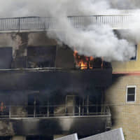 A Kyoto Animation Co. studio burns after a deadly attack on July 18 in Kyoto's Fushimi Ward. Three months after the fire, arson suspect Shinji Aoba, who suffered severe burns, has yet to recover enough to be arrested by police. | KYODO