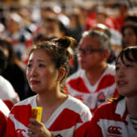 Fans watch the match between Japan and South Africa in Oita's fan zone on Oct. 20. | REUTERS