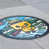 At the birthplace of instant noodles, Chicken Ramen mascot Hiyoko-chan is immortalized on manhole covers