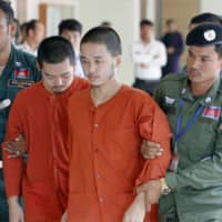 Cambodian court convicts two Japanese in murder of taxi driver