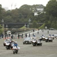 Official cars flanked by police outriders take part in a rehearsal in Tokyo on Oct. 6 for the upcoming parade to mark Emperor Naruhito's enthronement. | KYODO