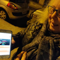 Spanish retiree Joanna Perez Osuna uses her mobile phone to play Pokemon Go on a daily basis in her hometown of Badalona in northern Spain. | BADALONA CARE SERVICES / VIA REUTERS