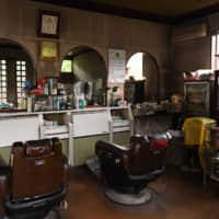 Chairs remain vacant in a barber shop in Gojome, Akita Prefecture, on Sept. 6. | BLOOMBERG