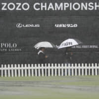 Heavy rains Friday postponed the second round of the Zozo Championship golf tournament being held in Inzai, Chiba Prefecture. | AP