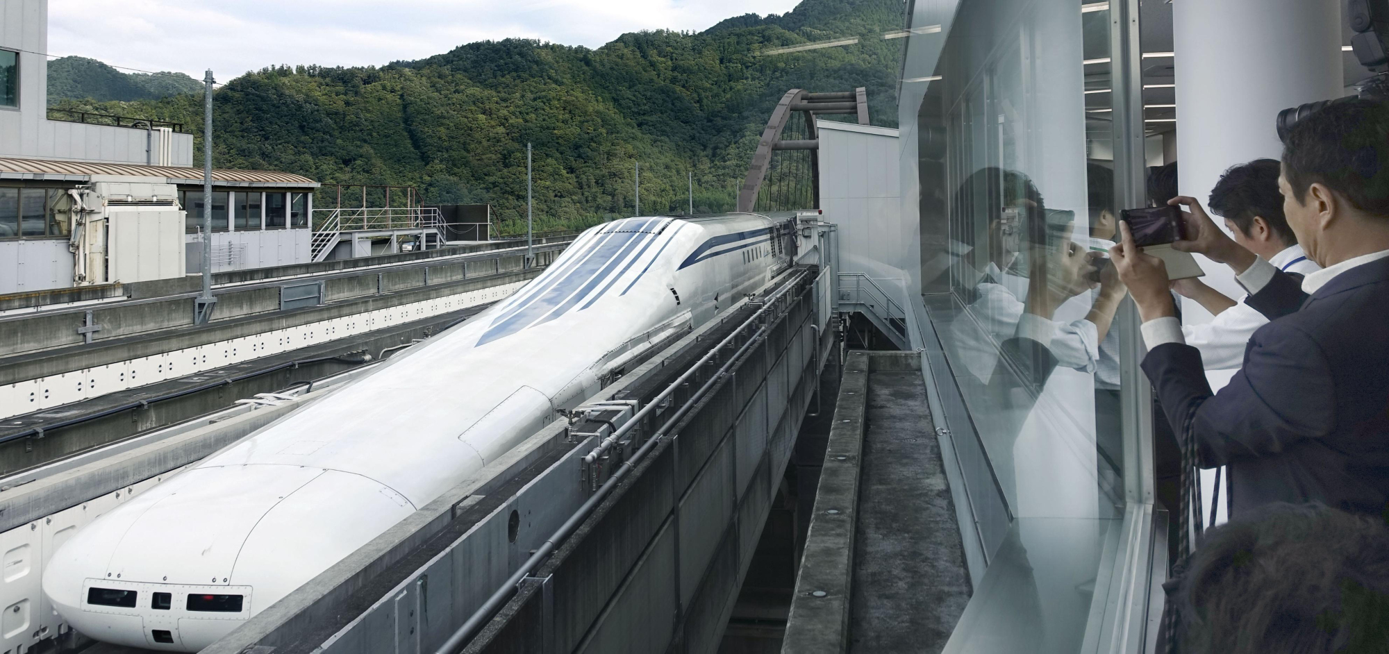 A prototype of Central Japan Railway Co.'s maglev train is unveiled to the media at the railway operator's experimental laboratory in Tsuru, Yamanashi Prefecture, on Oct. 3. | KYODO