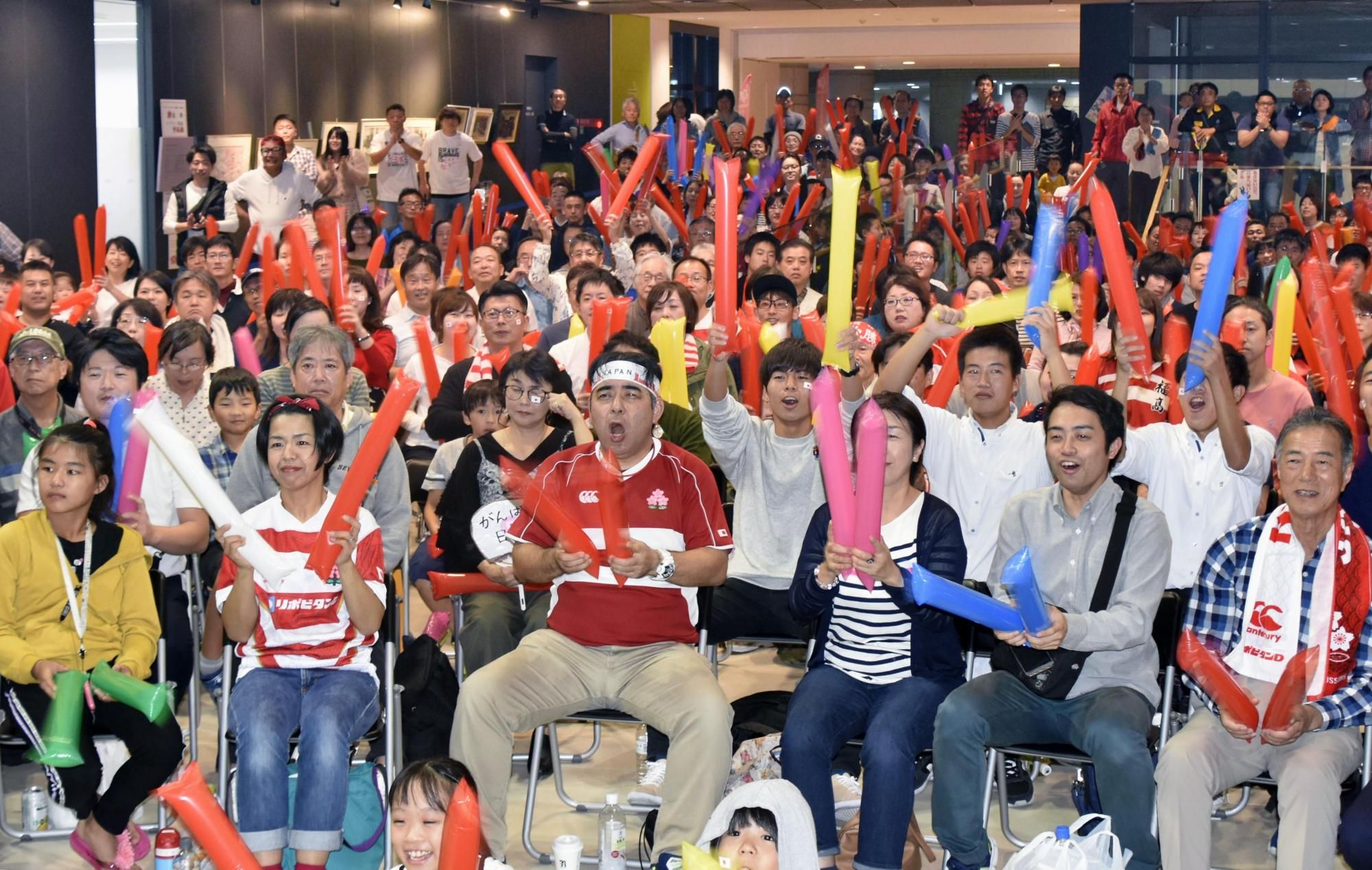 Japan supporters cheer at a public screening in the city of Koga, Fukuoka Prefecture, during the Rugby World Cup quarterfinal against South Africa on Sunday. | KYODO