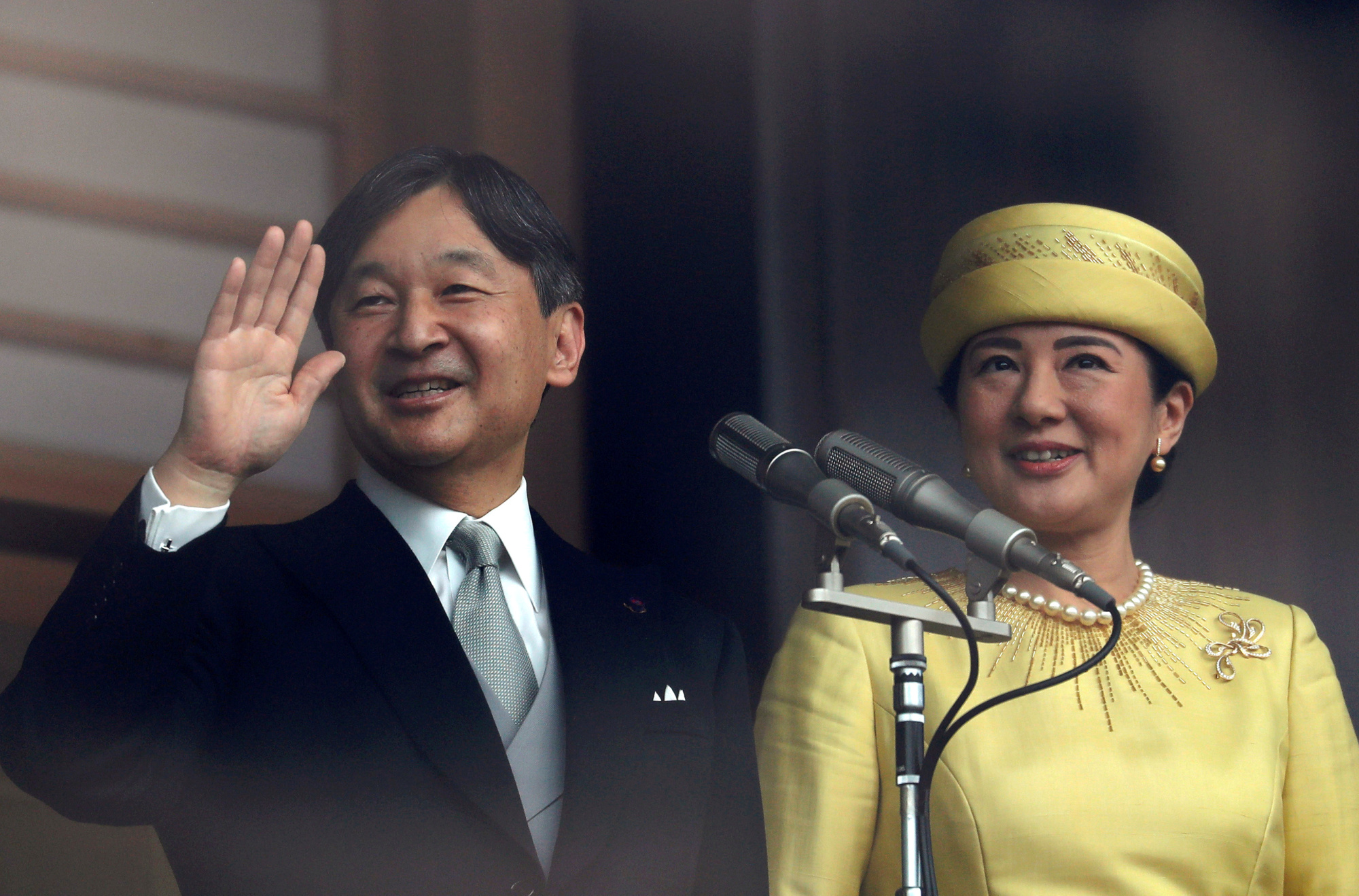Emperor Naruhito and Empress Masako greet well-wishers during their first public appearance at the Imperial Palace in Tokyo on May 4.   REUTERS