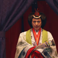 Empress Masako makes her appearance Tuesday during a ceremony to proclaim Emperor Naruhito's enthronement at the Imperial Palace in Tokyo.   AP