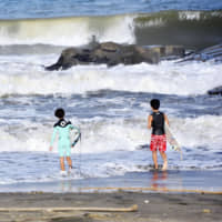 Surfers hit the waves at Tsurigasaki beach in Ichinomiya, Chiba Prefecture, which will host the surfing events for the Tokyo 2020 Olympics. | ??