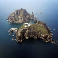 A set of remote islands, called Dokdo in South Korea and Takeshima in Japan, is seen in this picture taken from a helicopter in 2012. | REUTERS