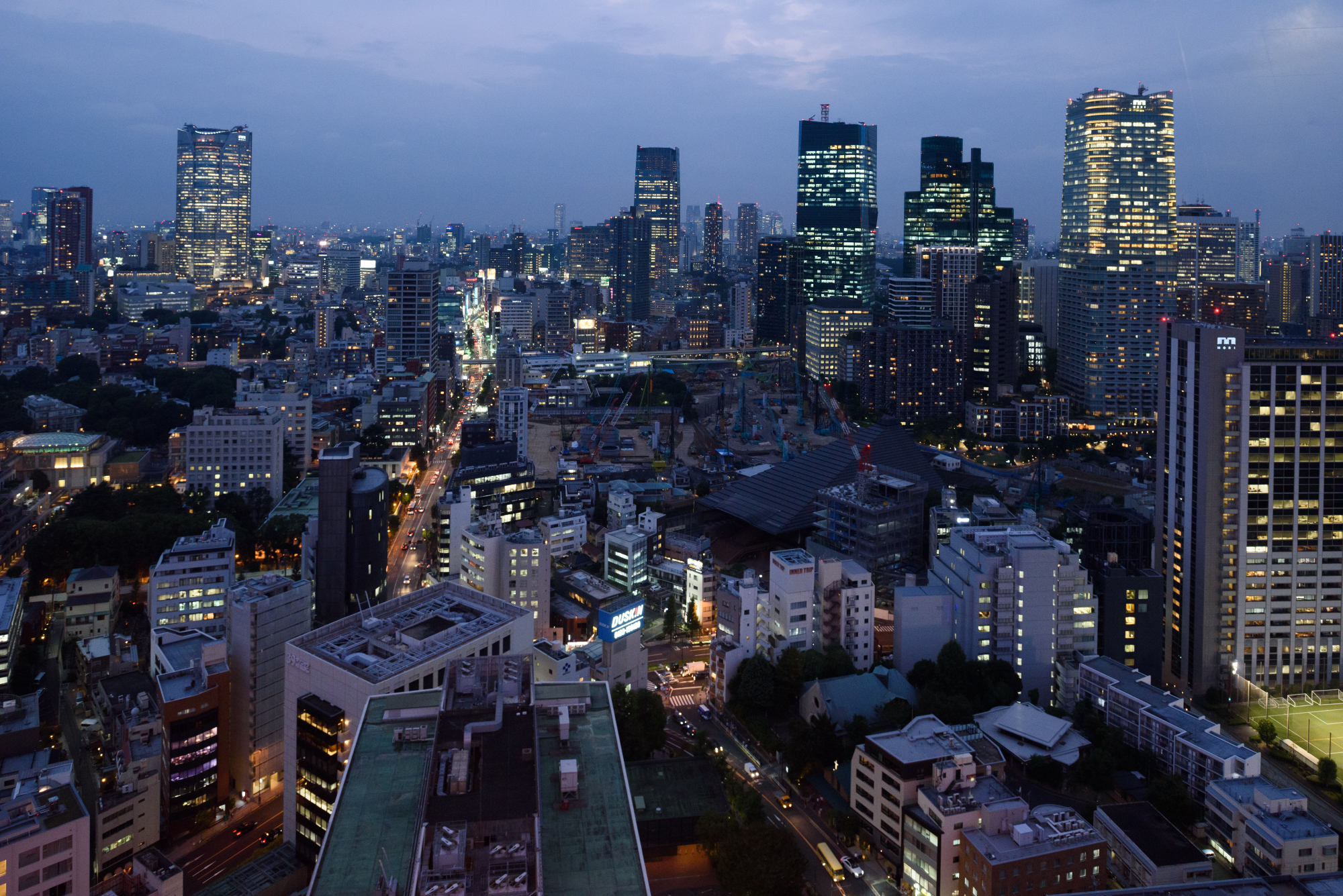 Buildings are illuminated at night in Tokyo earlier this month. | BLOOMBERG