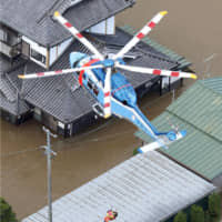A helicopter carries out a rescue mission in Sukagawa, Fukushima Prefecture, after the city was inundated with flood waters from the Abukuma River. | KYODO