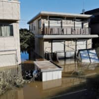 A flooded neighborhood in Kawasaki following the heavy rains of Typhoon Hagibis. | REUTERS