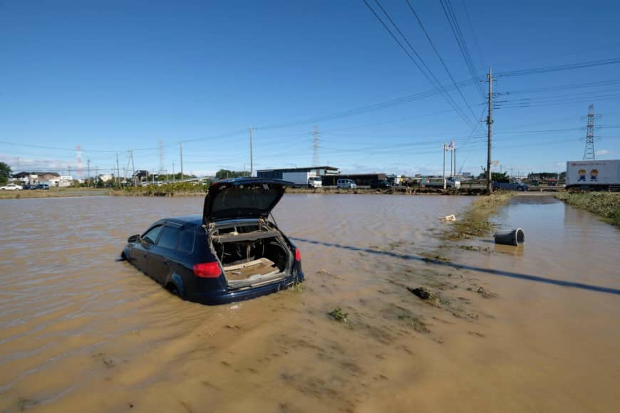 A car sits in a flooded field in Higashimatsuyama, Saitama Prefecture, after Typhoon Hagibis swept through central and eastern Japan. | AFP-JIJI