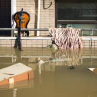 Floating debris is seen in a residential block as floodwaters recede in the aftermath of Typhoon Hagibis in Kawasaki. | AFP-JIJI