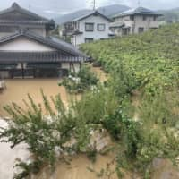 Flooding is seen in the city of Nagano in the wake of Typhoon Hagibis on Sunday. | CHISATO TANAKA