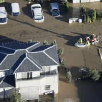 Aerial photo of rescue workers on Sunday morning in Sakado, Saitama Prefecture, following the heavy rains of Typhoon Hagibis.  | KYODO
