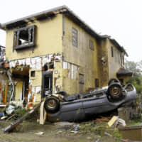 This house and car are believed to have been wrecked by a tornado in Ichihara, Chiba Prefecture, on Saturday morning.  | KYODO