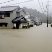 Heavy rains caused by Typhoon Hagibis flood a residential area in Ise, Mie Prefecture.  | KYODO