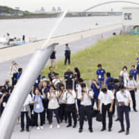 Organizers of the 2020 Tokyo Olympics test whether artificial snow can be used to cool spectators. | KYODO