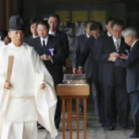 A group of lawmakers visit Yasukuni Shrine in Tokyo on Friday. | KYODO