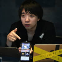 Professor and Pixie Dust Inc. CEO Yoichi Ochiai posits that the technology behind remote smartphone-controlled crane game apps could be integrated into convenience store jobs in the future. | YOSHIAKI MIURA