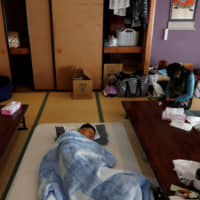 Seeking shelter: People rest at an evacuation center in the aftermath of Typhoon Hagibis in Date, Fukushima Prefecture. | REUTERS