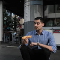 Take it to go: Those looking for extra savings will want to take their German hot dogs from Doutor to go so as to avoid the recent consumption tax rise. | JESSE CHASE-LUBITZ