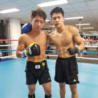 Monsters and men: Naoya 'The Monster' Inoue (right) and Japhethlee Llamido take a picture in the sparring ring in Yokohama.   HIDEKI SATO