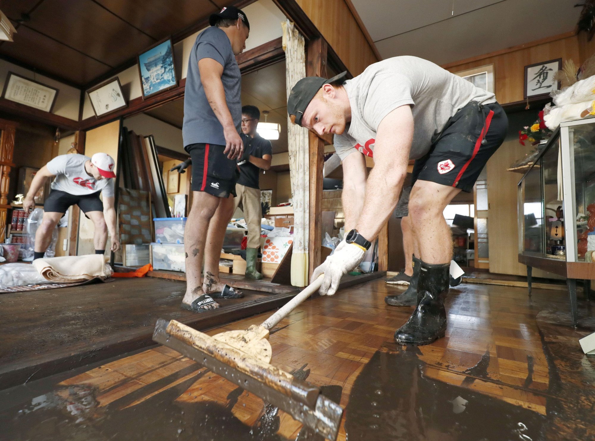 Good guests: Members of the Canadian rugby team help clean up in Fukushima Prefecture after it was hit by Typhoon Hagibis earlier this month. | REUTERS