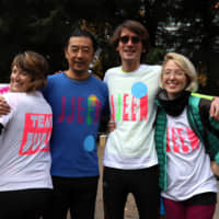 The JJEEM team: Supporting Julia Marino (far right) at the Run for the Cure in Hibiya Park last December are (from left) Elizabeth Mueller Shimizu, Eiji Shimizu, Julien Mauroy and Miho Ota (not pictured). | COURTESY OF JULIA MARINO
